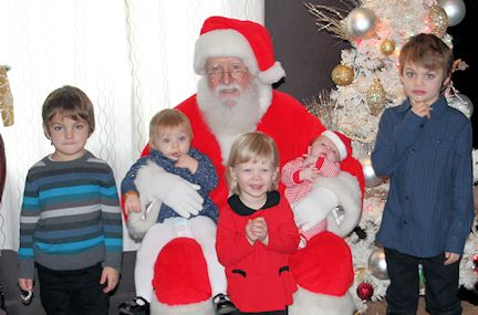 Santa greets children during Brunch at the Bruce Inn