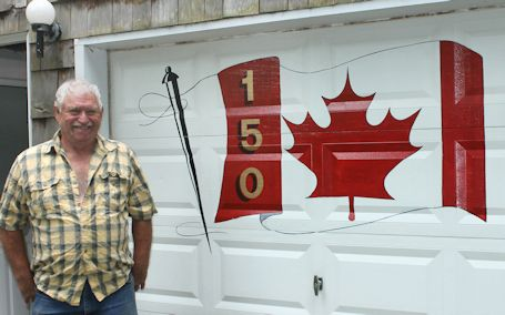 Kincardine man paints Canada-150 flag on garage door