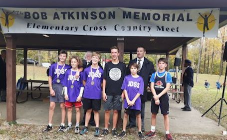 Casey Beisel of Huron Heights wins gold at cross-country meet